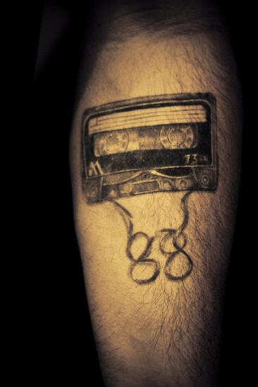 cassette tattoo design on leg
