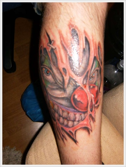 hurt leg clown tattoo design