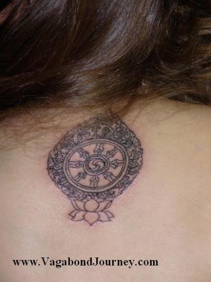tibetan tattoo design on upper back