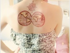 world compass tattoo on back