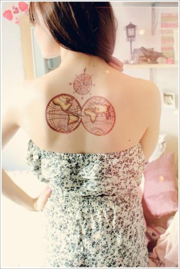 world compass tattoo on back