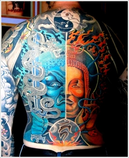 yin yang tattoo on upper back
